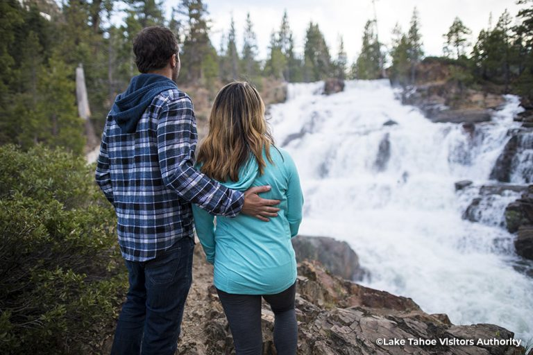 Couple standing by Glenn Apline Falls, South Lake Tahoe