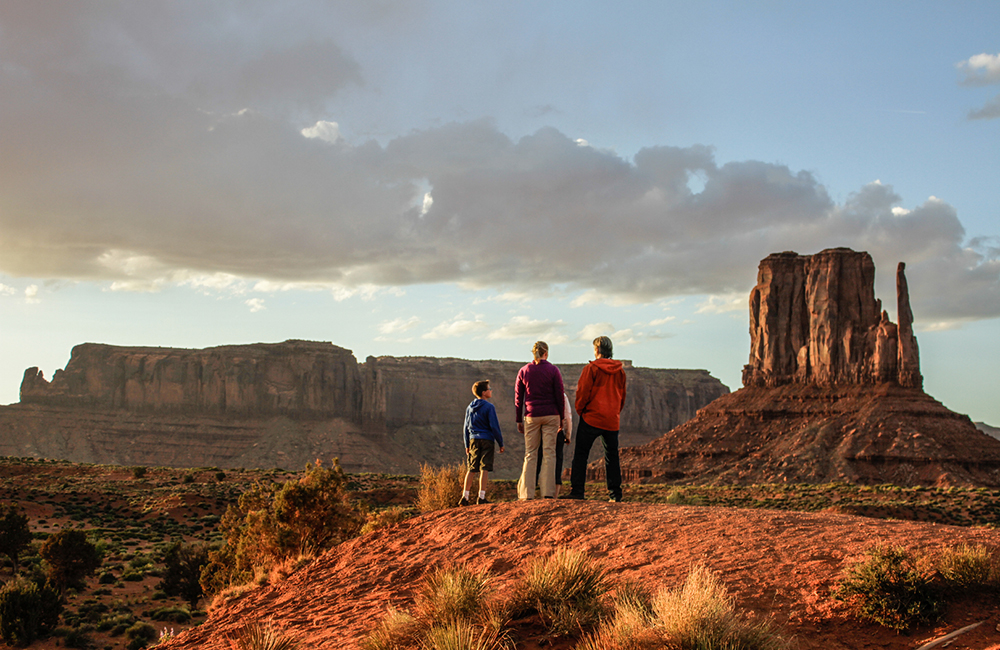 A family standing in Monument Valley