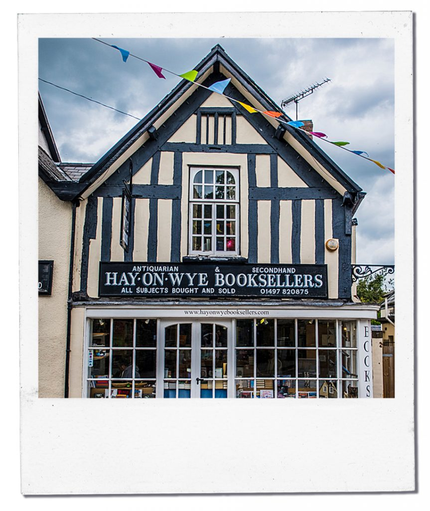 a polaroid of a secondhand bookshop in Hay-On-Wye on a cloudy day